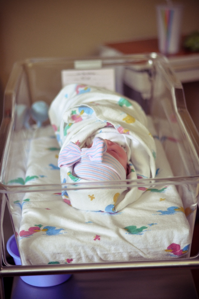 Baby in hospital bassinet.